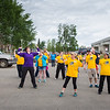 "Participants in the 2016 Special Olympics Torch Run warm-up before starting the 5-kilometer run Saturday, May 21, 2016.  <div class=""ss-paypal-button"">Filename: LIF-16-4908-5.jpg</div><div class=""ss-paypal-button-end""></div>"
