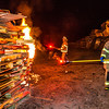 """Jared William Conrad, right, joined Chancellor Rogers Saturday night in lighting the annual Starvation Gulch bonfires. Conrad won a drawing sponsored by UAF Traditions which allowed him the honor which is now bestowed upon a student each year.  <div class=""""ss-paypal-button"""">Filename: LIF-12-3571-130.jpg</div><div class=""""ss-paypal-button-end"""" style=""""""""></div>"""