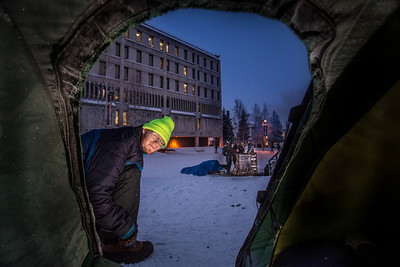 Matthew Carrick puts in his time at the week-long homeless vigil maintained 24-hours-a day in Constitution Park by students in the UAF Honors Program. The temperature at the time was a brisk -30°.  Filename: LIF-13-4002-23.jpg