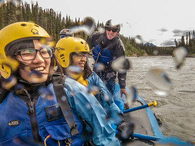International students Ko-Fan Lu, front, and Chien-An Peng joined UAF Outdoor Adventures recreation manager Sam Braband and others on a raft trip down the Nenana River in June, 2014.  Filename: OUT-14-4211-089.jpg