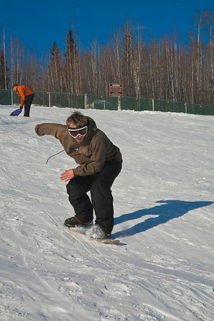 """Bryan Johnson tries out his snow skate on the SRC Hill on a sunny day in February.  <div class=""""ss-paypal-button"""">Filename: LIF-12-3289-69.jpg</div><div class=""""ss-paypal-button-end"""" style=""""""""></div>"""