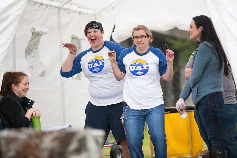 """Ashley Bowen and Mary-Clare Cable compete in a dance off with other orientation leaders across the tent during UAF Orientation's Move-In Day Sunday, August 26, 2012 in front of the Moore, Bartlett, and Skarland dormitory complex.  <div class=""""ss-paypal-button"""">Filename: LIF-12-3511-184.jpg</div><div class=""""ss-paypal-button-end"""" style=""""""""></div>"""