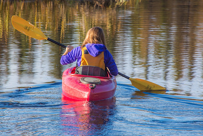 Business major Shelby Carlson enjoys a morning paddle on Ballaine Lake.  Filename: LIF-12-3562-001.jpg