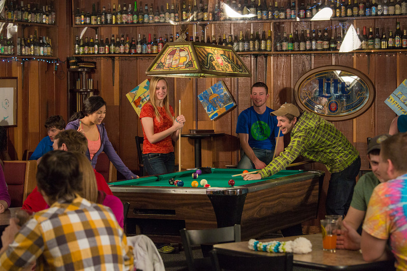 """Students unwind over a game of pool in the Wood Center Pub on the Fairbanks campus. (Note: Taken as part of commercial shoot with Nerland Agency -- use with discretion!)  <div class=""""ss-paypal-button"""">Filename: LIF-12-3563-062.jpg</div><div class=""""ss-paypal-button-end"""" style=""""""""></div>"""