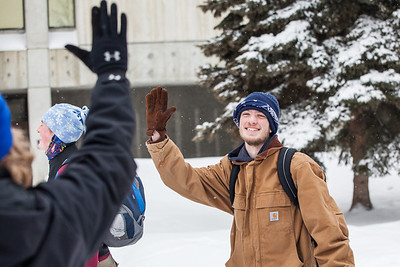 Participant Andrew Sharp, gives a celebratory high five to a fellow student at a UAF ResLife-sponsored Human vs. Zombies game on campus.  Filename: LIF-13-3784-122.jpg