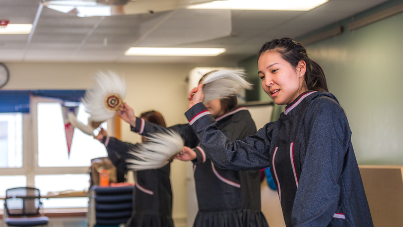 """Larissa Flynn and other members of the KuC Yuraq Dance Group practice in the school's conference room on March 30. Flynn is a certificate pre-nursing student from Chefornak and a resident of Sackett Hall on the Kuskokwim Campus.  <div class=""""ss-paypal-button"""">Filename: LIF-16-4859-397.jpg</div><div class=""""ss-paypal-button-end""""></div>"""