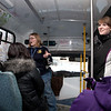 "Volunteer leaders Courtney Enright, standing at left, and Alexandra Roberts lead new students on a shuttle bus tour around campus during a new student orientation session on the Fairbanks campus.  <div class=""ss-paypal-button"">Filename: LIF-12-3258-33.jpg</div><div class=""ss-paypal-button-end"" style=""""></div>"
