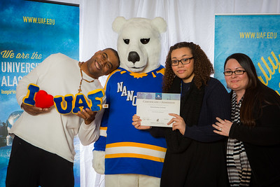Parents and prospective students pose with the UAF mascot during the Fall 2015 Inside Out event hosted by UAF's office of admissions and the registrar.  Filename: LIF-14-4353-76.jpg