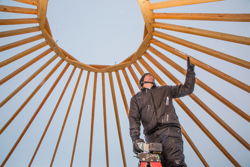 """Sam Braband, outdoor facilities manager with UAF's Department of Recreation, Adventure and Wellness, prepares to mount some hardware during construction of a yurt at the top of the new terrain park.  <div class=""""ss-paypal-button"""">Filename: LIF-13-3691-8.jpg</div><div class=""""ss-paypal-button-end"""" style=""""""""></div>"""