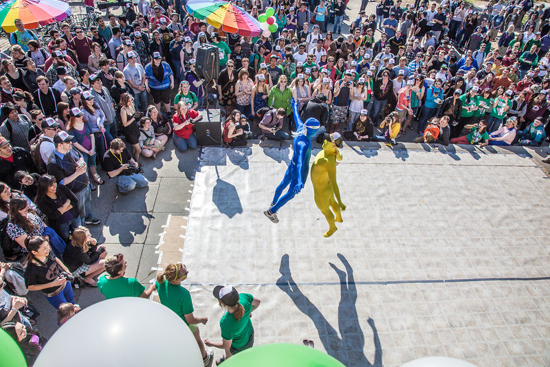 """Costumed dancers help kick off the annual SpringFest celebration in front of the Wood Center.  <div class=""""ss-paypal-button"""">Filename: LIF-12-3373-052.jpg</div><div class=""""ss-paypal-button-end"""" style=""""""""></div>"""