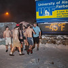 "A group of hardy UAF students get ready to join the 40° below club by posing in their shorts or swimsuits by the time &amp; temperature sign at an extreme temperature of 40° below or colder.  <div class=""ss-paypal-button"">Filename: LIF-12-3269-17.jpg</div><div class=""ss-paypal-button-end"" style=""""></div>"