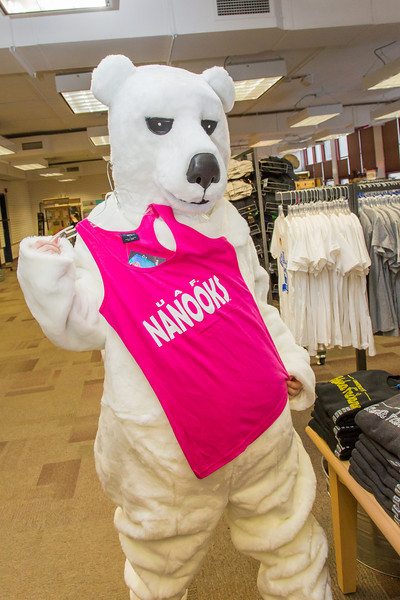 """The UAF mascot shops for some new clothes in the UAF Bookstore in Constitution Hall.  <div class=""""ss-paypal-button"""">Filename: LIF-14-4101-62.jpg</div><div class=""""ss-paypal-button-end"""" style=""""""""></div>"""