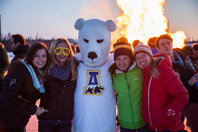 Participants from the 2013 USSA Junior National Cross Country Ski Championships pose for a photo at a bonfire after the awards ceremony at the Student Recreation Center March 16, 2013.  Filename: LIF-13-3760-12.jpg