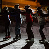 "A group of friends link up with each other during DRAW's skate under sthe stars program.  <div class=""ss-paypal-button"">Filename: LIF-14-4082-10.jpg</div><div class=""ss-paypal-button-end""></div>"