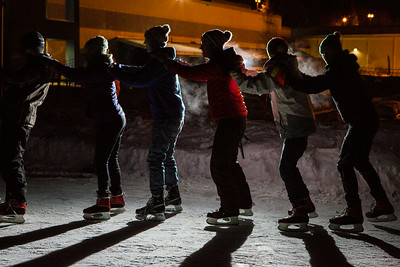 A group of friends link up with each other during DRAW's skate under sthe stars program.  Filename: LIF-14-4082-10.jpg