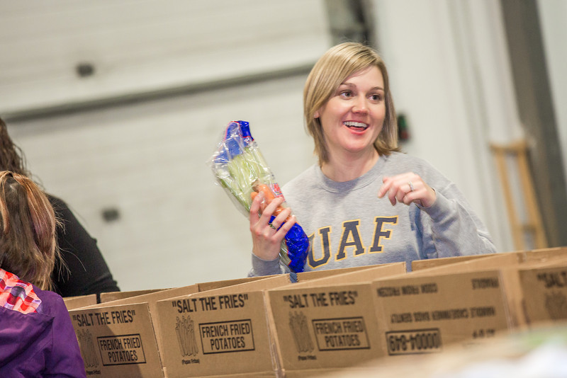"""SFOS fiscal officer Jennifer Harris was one of many UAF employees who volunteered at the Fairbanks Food Bank in 2012.  <div class=""""ss-paypal-button"""">Filename: LIF-12-3661-54.jpg</div><div class=""""ss-paypal-button-end"""" style=""""""""></div>"""