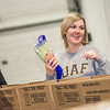 "SFOS fiscal officer Jennifer Harris was one of many UAF employees who volunteered at the Fairbanks Food Bank in 2012.  <div class=""ss-paypal-button"">Filename: LIF-12-3661-54.jpg</div><div class=""ss-paypal-button-end"" style=""""></div>"