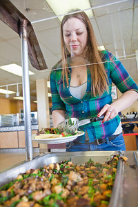 Junior Anastasia Brease loads up on vegetables during lunch in the Lola Tilly Commons.  Filename: LIF-11-3220-104.jpg