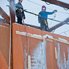 "Staff members with UAF's Outdoor Adventures adjust the flow as water drips from the pipes to form a wall for ice climbing on the new outdoor tower by the Student Recreation Center.  <div class=""ss-paypal-button"">Filename: LIF-11-3246-22.jpg</div><div class=""ss-paypal-button-end"" style=""""></div>"
