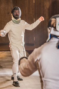 Joel Juenke spars with an opponent during a tournament held by members of the UAF Fencing Club Oct. 30 in the Wood Center ballroom.  Filename: LIF-14-4365-15.jpg