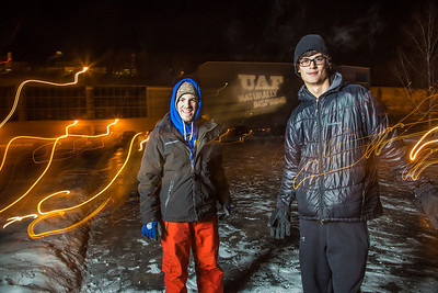 Walter DeSarro, left, and Danny Falkner have student jobs serving as referees for outdoor intramural broomball on the ice in front of the SRC.  Filename: LIF-12-3652-7.jpg