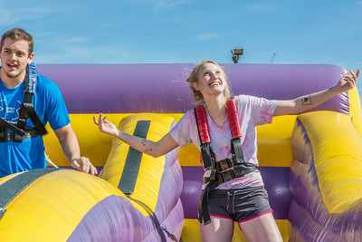 Matt Deatherage and Sam Harthun took a turn in the harness pull, one of many attractions brought to campus during UAF SpringFest Field Day on April 28.  Filename: LIF-14-4168-75.jpg