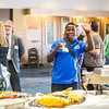 "International student Bertrand Dushime waves a at the camera at the International Student Mixer event sponsored by International Programs &amp; Initiatives.  <div class=""ss-paypal-button"">Filename: LIF-13-3927-16.jpg</div><div class=""ss-paypal-button-end"" style=""""></div>"