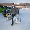 "Brandon Hoover loads aluminum cans from the MBS residence hall complex into the campus recycle bins.  <div class=""ss-paypal-button"">Filename: LIF-11-3210-02.jpg</div><div class=""ss-paypal-button-end"" style=""""></div>"