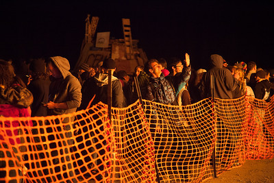 Students begin feeling the heat from the first lit bonfires at Starvation Gulch.  Filename: LIF-12-3573-5.jpg