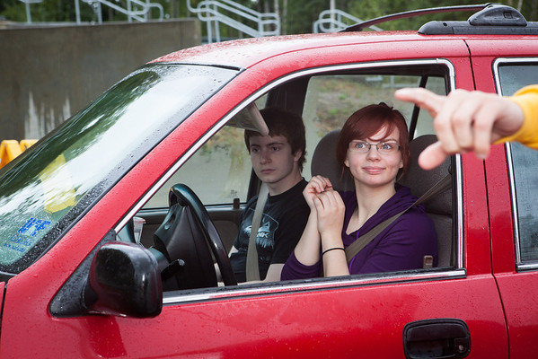 """Carolyn Deskins receives vehicle instructions when entering the front parking lot of the Moore, Bartlett, and Skarland dormitory complex Sunday, August 26, 2012 during Move-In Day.  <div class=""""ss-paypal-button"""">Filename: LIF-12-3511-192.jpg</div><div class=""""ss-paypal-button-end"""" style=""""""""></div>"""