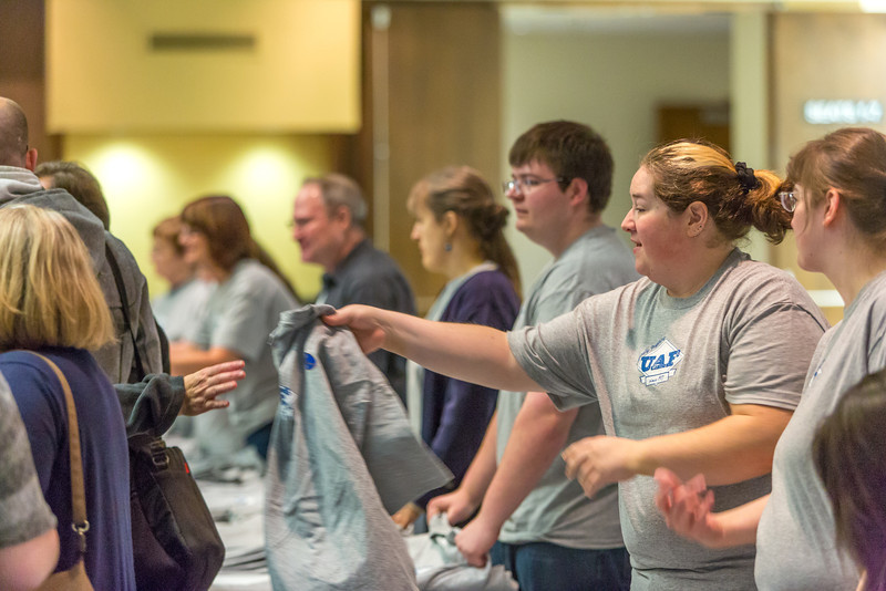 "Staff members of UAF's Marketing and Communications office were on hand to give out free t-shirts to those attending the chancellor's annual convocation address in the Davis Concert Hall.  <div class=""ss-paypal-button"">Filename: LIF-13-3945-115.jpg</div><div class=""ss-paypal-button-end"" style=""""></div>"