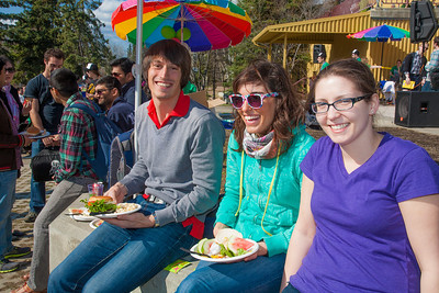 Erik Soederstroem (left), Theresia Schnurr (center) and Terilyn Lawson (right) eat lunch in front of the Wood Center on campus during the Spring Fest kick off barbeque.  Filename: LIF-12-3375-50.jpg