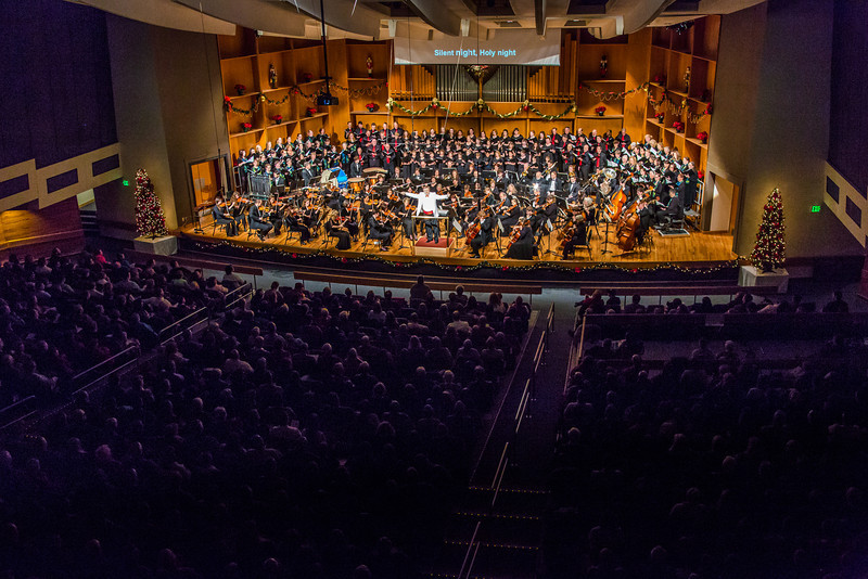 """Conductor Eduard Zilberkant turns around to lead the audience in song during the Fairbanks Symphony's annual holiday concert in the Davis Concert Hall.  <div class=""""ss-paypal-button"""">Filename: LIF-13-4016-157.jpg</div><div class=""""ss-paypal-button-end"""" style=""""""""></div>"""
