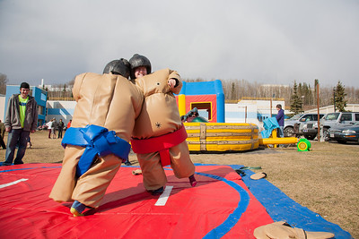Ashley Bartolowits (left) and her sister Jennifer (right) compete in sumo suits at the Spring Fest Field Day.  Filename: LIF-12-3381-9.jpg