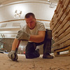 "Nelson Harker with MacChayne's Carpet Plus prepares the subfloor in the Wood Center Ballroom before installation of a new floor.  <div class=""ss-paypal-button"">Filename: LIF-11-3244-11.jpg</div><div class=""ss-paypal-button-end"" style=""""></div>"