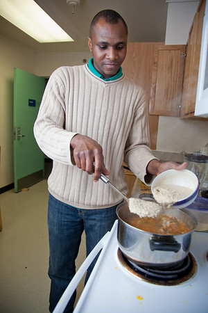 Peter Ikewun, a petroleum engineeering graduate student from Nigeria, prepares a traditional African soup in his communal Wickersham Hall kitchen.  Filename: LIF-12-3268-164.jpg
