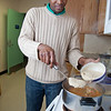 "Peter Ikewun, a petroleum engineeering graduate student from Nigeria, prepares a traditional African soup in his communal Wickersham Hall kitchen.  <div class=""ss-paypal-button"">Filename: LIF-12-3268-164.jpg</div><div class=""ss-paypal-button-end"" style=""""></div>"