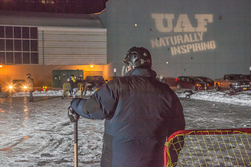 "Outdoor broomball, played on the ice in front of the SRC, is a popular intramural sport at UAF.  <div class=""ss-paypal-button"">Filename: LIF-12-3652-105.jpg</div><div class=""ss-paypal-button-end"" style=""""></div>"