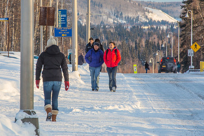 Students walk along Yukon Drive on the first day of classes in the spring 2013 semester.  Filename: LIF-13-3699-9.jpg