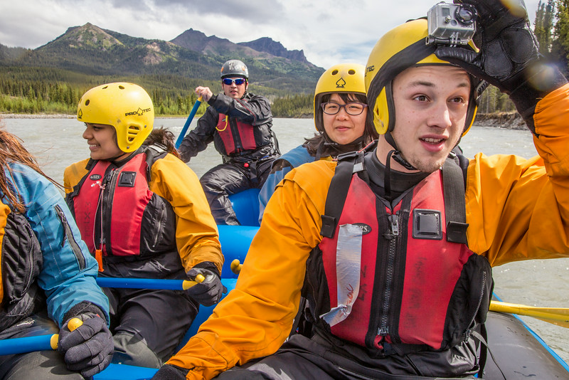"""Biology major Isaac Van Flein adjusts the GoPro mounted on his helmet during a UAF Outdoor Adventures float trip down the Nenana River in June, 2014.  <div class=""""ss-paypal-button"""">Filename: OUT-14-4211-231.jpg</div><div class=""""ss-paypal-button-end""""></div>"""