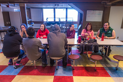Students relax after a day of classes in the Sacket Hall dining room on UAF's Kuskokwim Campus in Bethel.  Filename: LIF-16-4859-505-2.jpg