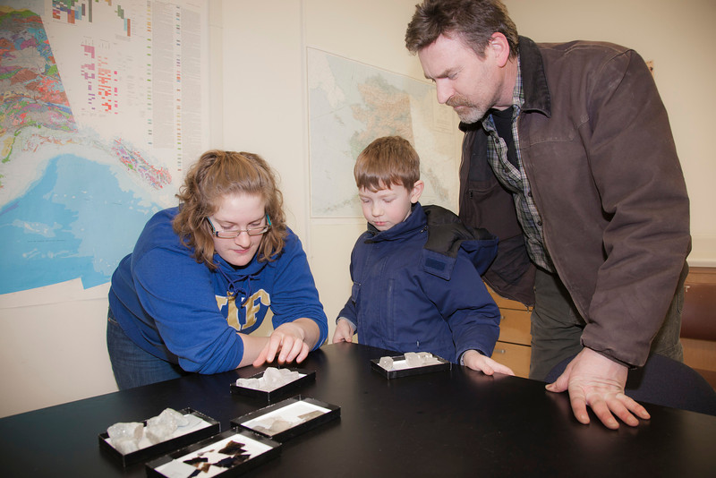 """Engineering student Maggie Yngve (left) shows different types of rocks to Dale and Kade Rowland at the annual Eweek open house in the Duckering building on campus.  <div class=""""ss-paypal-button"""">Filename: LIF-12-3302-44.jpg</div><div class=""""ss-paypal-button-end"""" style=""""""""></div>"""