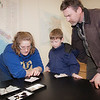 "Engineering student Maggie Yngve (left) shows different types of rocks to Dale and Kade Rowland at the annual Eweek open house in the Duckering building on campus.  <div class=""ss-paypal-button"">Filename: LIF-12-3302-44.jpg</div><div class=""ss-paypal-button-end"" style=""""></div>"
