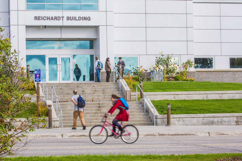 """Students come and go and pass by the Reichardt Building on the first day of the 2013 fall semester.  <div class=""""ss-paypal-button"""">Filename: LIF-13-3928-82.jpg</div><div class=""""ss-paypal-button-end"""" style=""""""""></div>"""