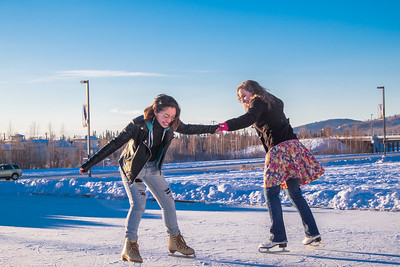 Music majors Sarah Riopelle, right, and Rose Crelli find time between classes to have fun on the ice rink in front of the SRC on a sunny January afternoon.  Filename: LIF-15-4428-75.jpg
