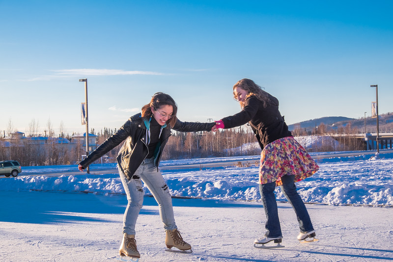 """Music majors Sarah Riopelle, right, and Rose Crelli find time between classes to have fun on the ice rink in front of the SRC on a sunny January afternoon.  <div class=""""ss-paypal-button"""">Filename: LIF-15-4428-75.jpg</div><div class=""""ss-paypal-button-end""""></div>"""