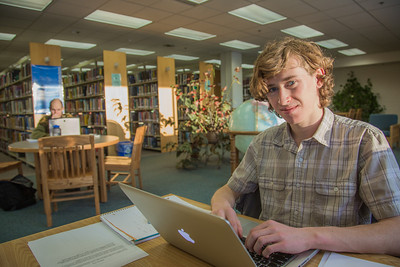 Freshman political science major Jake Gerrish catches up on some studying on the 5th floor of the Rasmuson Library.  Filename: LIF-14-4045-108.jpg