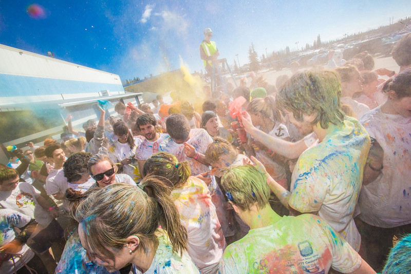 "Students enjoy getting doused with colored dye before participating in a 5-kilometer run during SpringFest on the Fairbanks campus.  <div class=""ss-paypal-button"">Filename: LIF-13-3805-77.jpg</div><div class=""ss-paypal-button-end"" style=""""></div>"