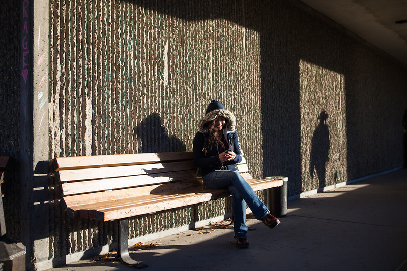 "A student listens to music outside the Gruening Building in October.  <div class=""ss-paypal-button"">Filename: LIF-12-3585-17.jpg</div><div class=""ss-paypal-button-end"" style=""""></div>"