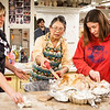 "From left, Danielle Anderson, Mary Blurton, and Teresa Shannon carve a turkey before the feasting begins at the annual Thanksgiving gathering at the ceramics department.  <div class=""ss-paypal-button"">Filename: LIF-12-3660-34.jpg</div><div class=""ss-paypal-button-end"" style=""""></div>"